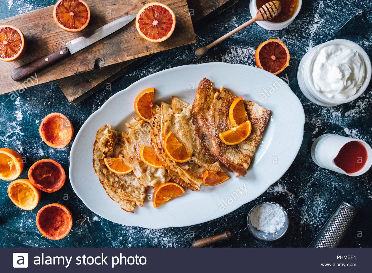 Pancakes with blood oranges - Stock Image