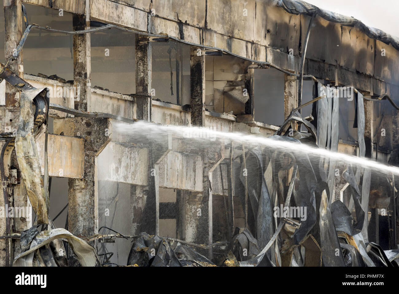 Large fire disaster in a warehouse - Stock Image