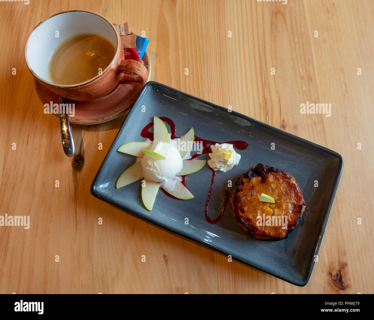 An apple turnover served with vanilla ice cream and coffee - Stock Image