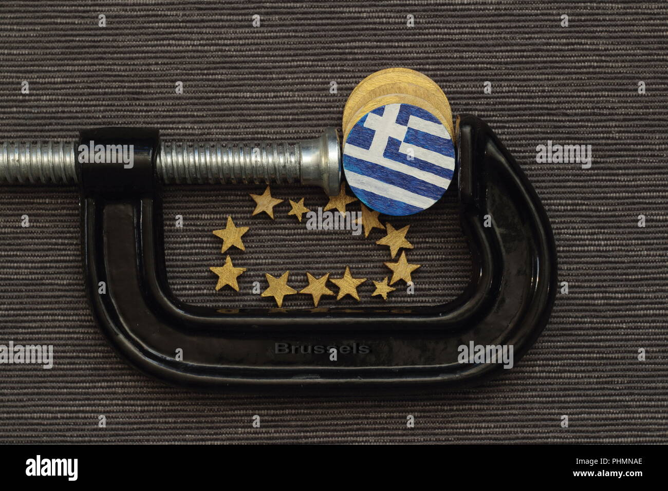 Greece coin is clamp pressure - Stock Image