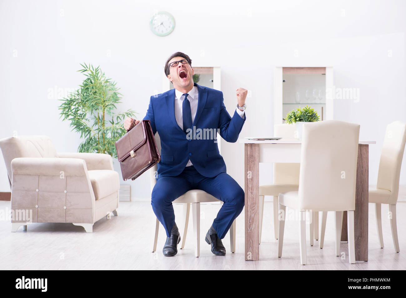 Bankrupt businessman angry and upset at home Stock Photo