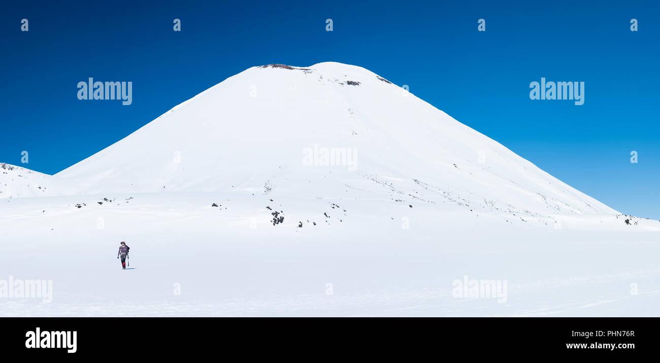 woman winter mountain walking in New Zealand National Park, Tongariro crossing - Stock Image