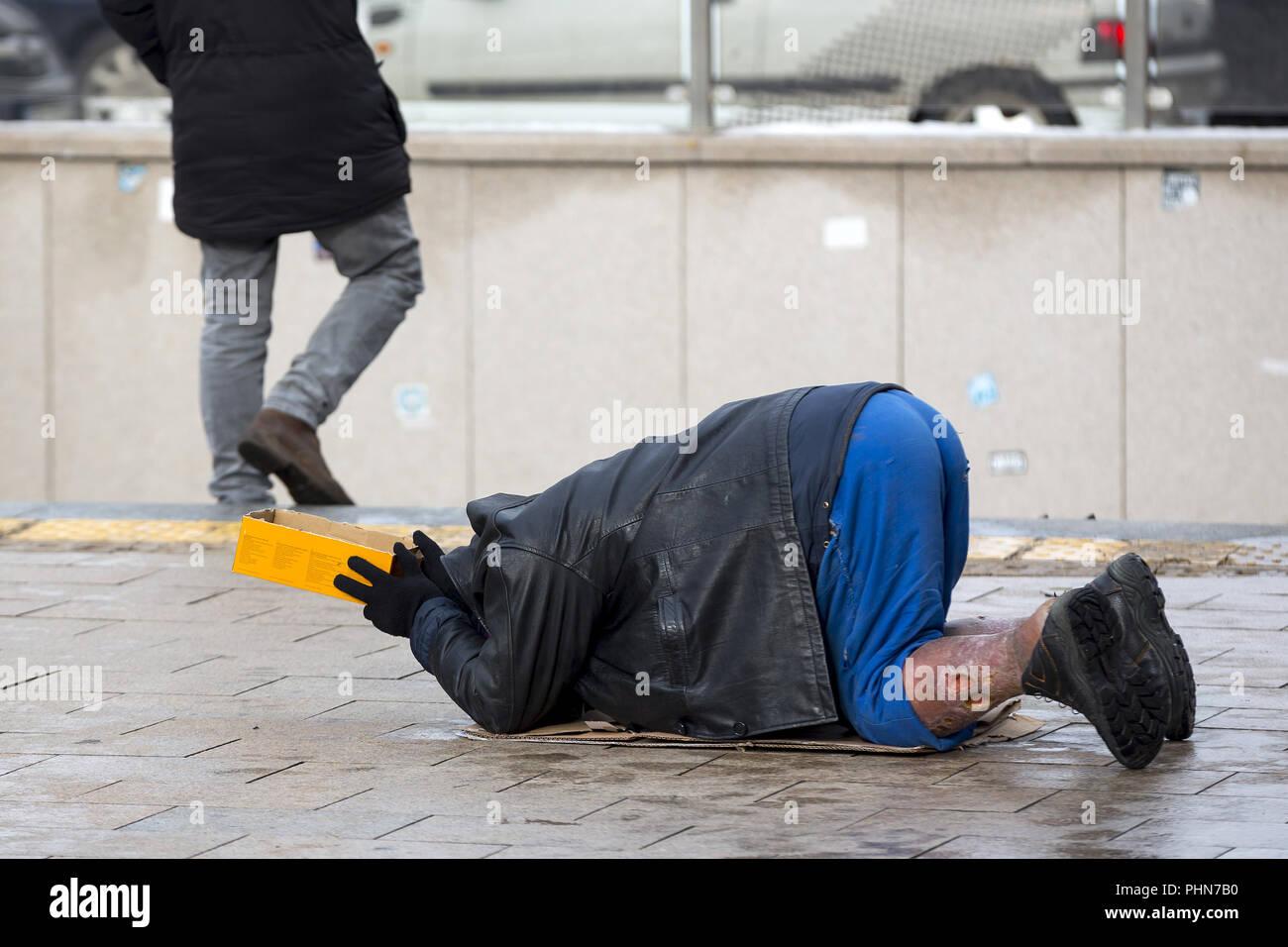 Poor Homeless Man Begg...