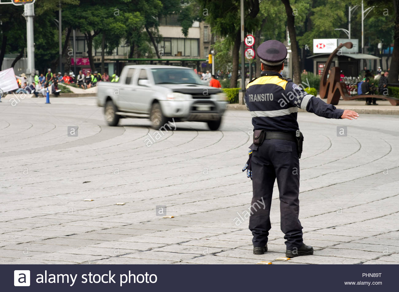 A transit police officer in Mexico City directs traffic on the Paseo de la Reforma. - Stock Image