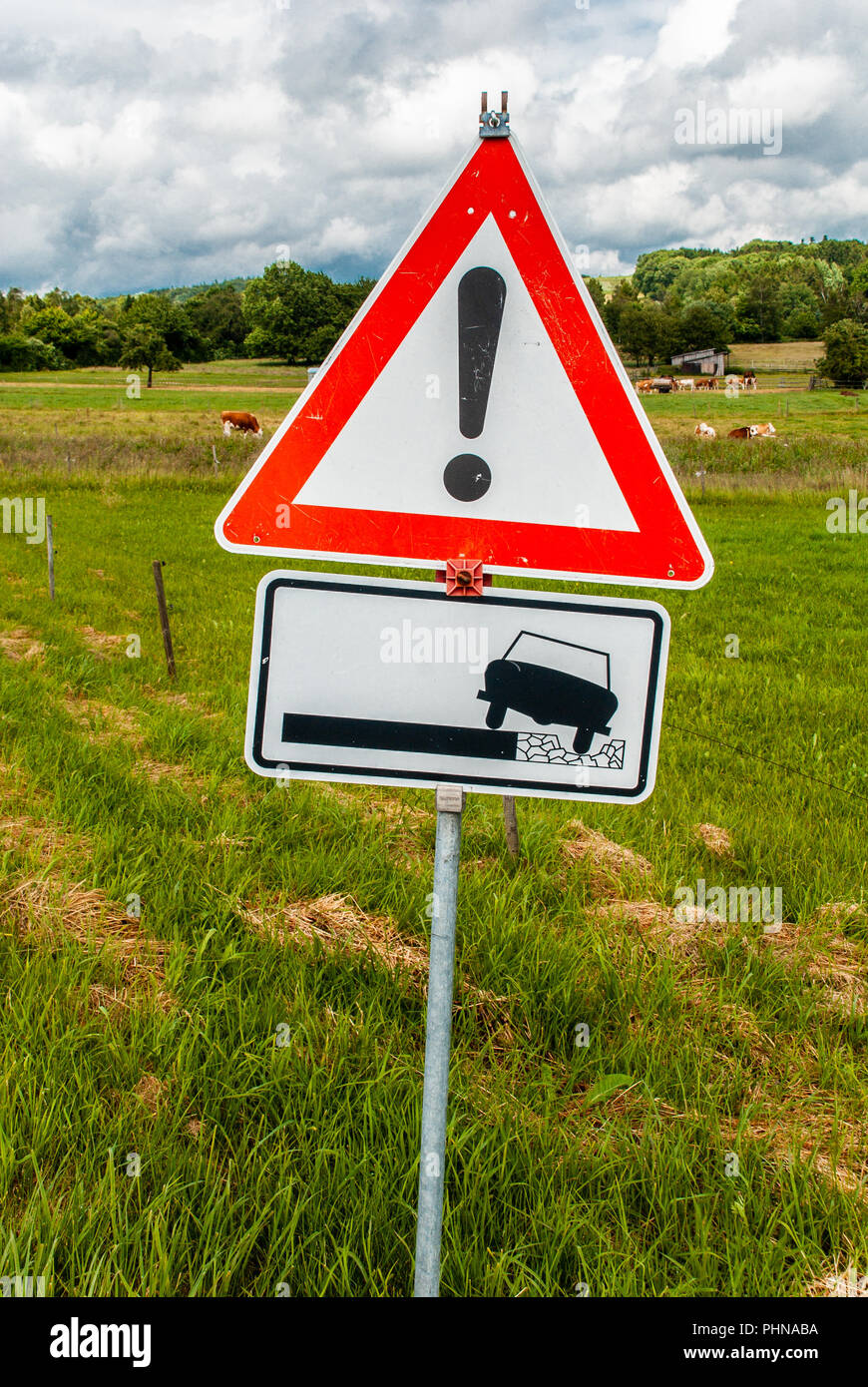 unpaved roadway sign, countryside - Stock Image