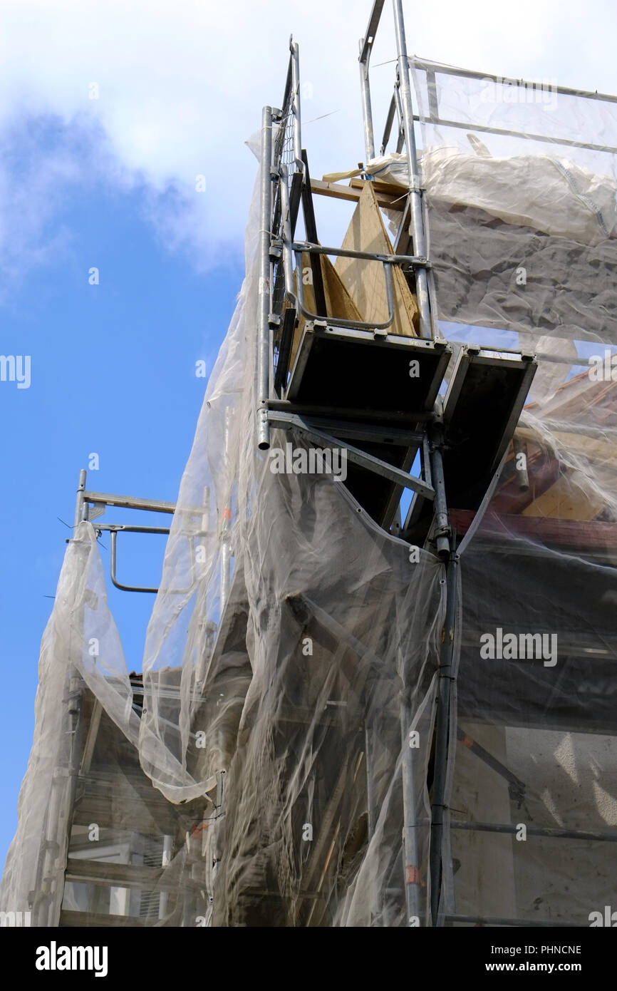 Scaffolding with protective nets - Stock Image