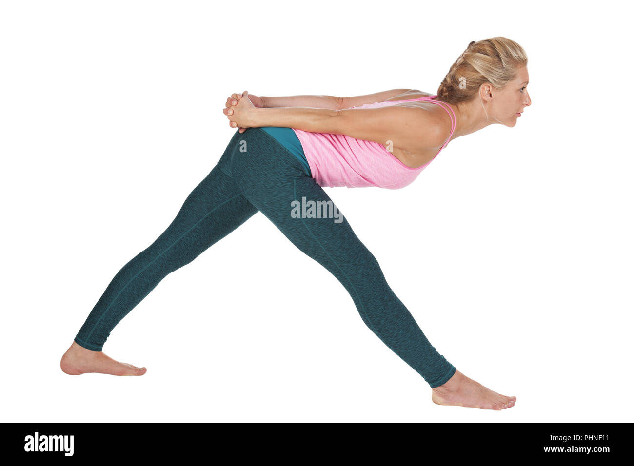 Yoga_side front over bend_high - Stock Image