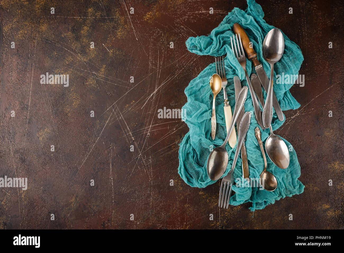 Kitchen utensils on dark background - Stock Image