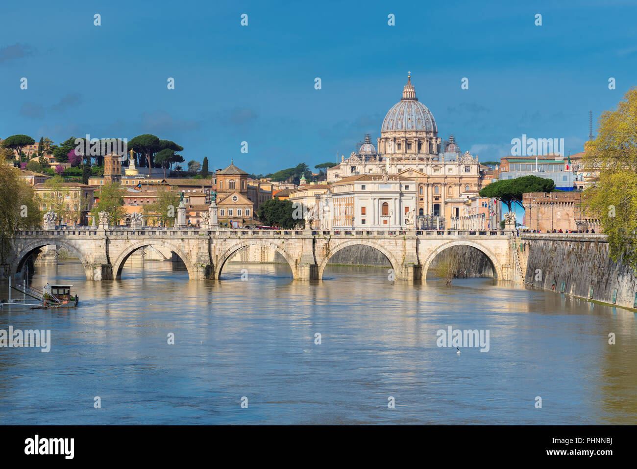 Beautiful view of St. Peter's cathedral with bridge in Vatican, Rome, Italy. - Stock Image