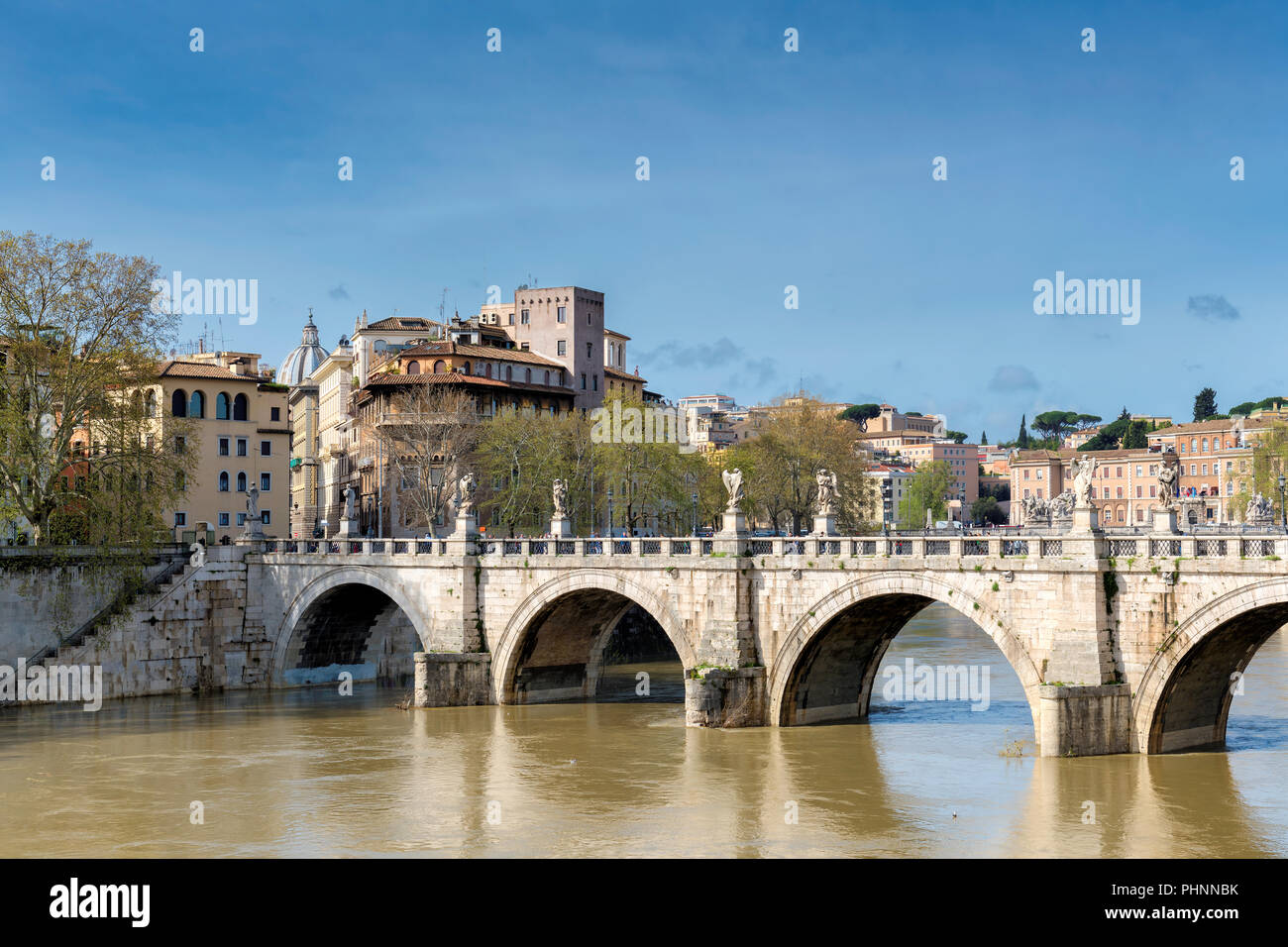 Rome downtown skyline with bridge on river Tiber at sunny day in Rome, Italy. - Stock Image