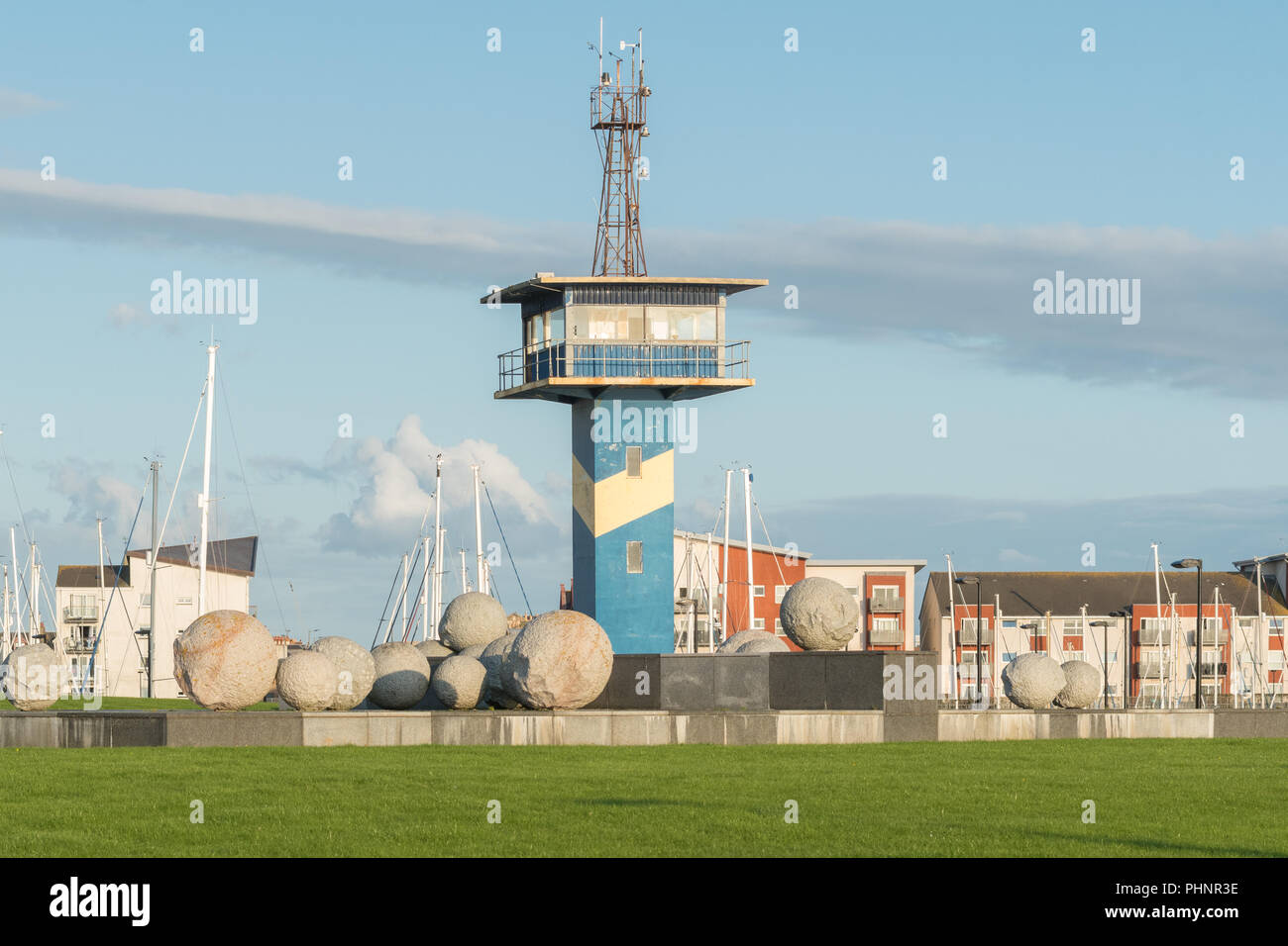 Ardrossan harbour station development - harbour masters watchtower and 'Position and Appearance' granite sphere sculpture, Ardrossan, Scotland, UK - Stock Image