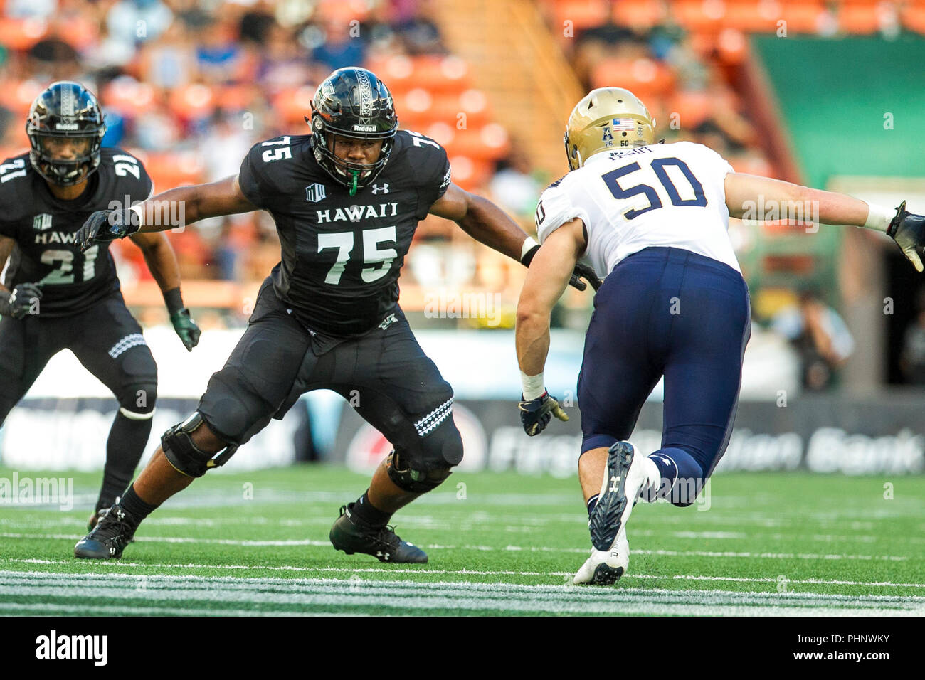 Honolulu, Hawaii, USA. 01st Sep, 2018. September 1, 2018 - Hawaii Rainbow Warriors offensive lineman Ilm Manning #75 blocks Navy Midshipmen linebacker Diego Fagot #50 during NCAA football game between the Navy Shipmen and the University of Hawaii Warriors at Hawaiian Airlines Field at Aloha Stadium in Honolulu, Hawaii. Glenn Yoza/CSM Credit: Cal Sport Media/Alamy Live News Stock Photo