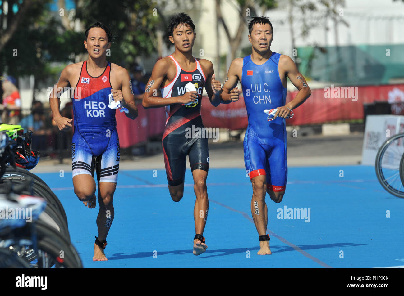 Palembang, Indonesia. 2nd Sep, 2018. Liu Chen (R) of China competes during mixed relay of Triathlon at the 18th Asian Games in Palembang, Indonesia, Sept. 2, 2018. Credit: Veri Sanovri/Xinhua/Alamy Live News - Stock Image