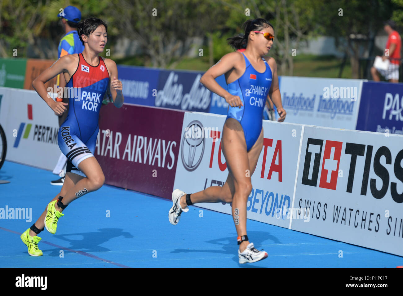 Palembang, Indonesia. 2nd Sep, 2018. Zhang Yi (R) of China competes during mixed relay of Triathlon at the 18th Asian Games in Palembang, Indonesia, Sept. 2, 2018. Credit: Veri Sanovri/Xinhua/Alamy Live News - Stock Image