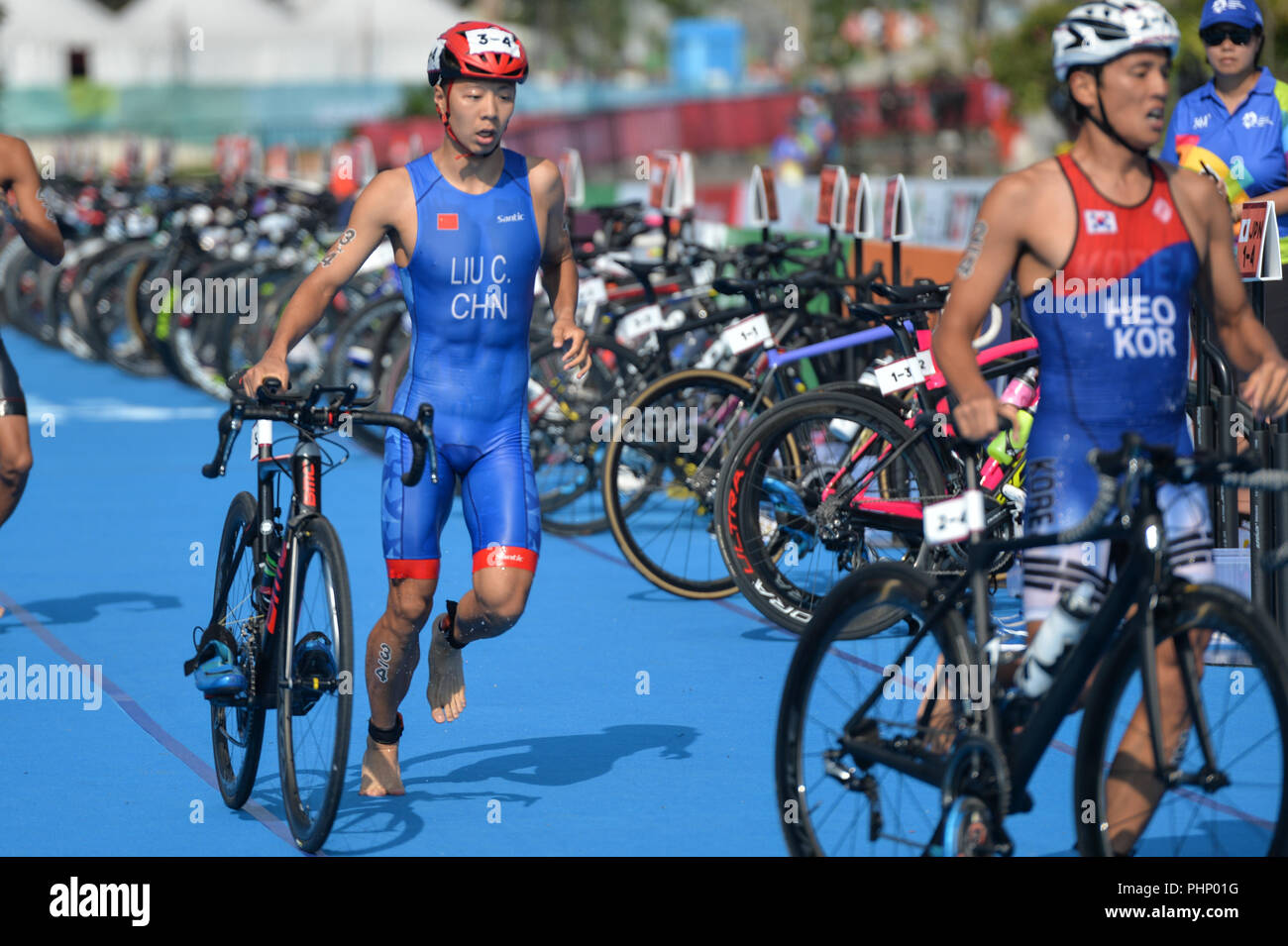 Palembang, Indonesia. 2nd Sep, 2018. Liu Chen (L) of China competes during mixed relay of Triathlon at the 18th Asian Games in Palembang, Indonesia, Sept. 2, 2018. Credit: Veri Sanovri/Xinhua/Alamy Live News - Stock Image