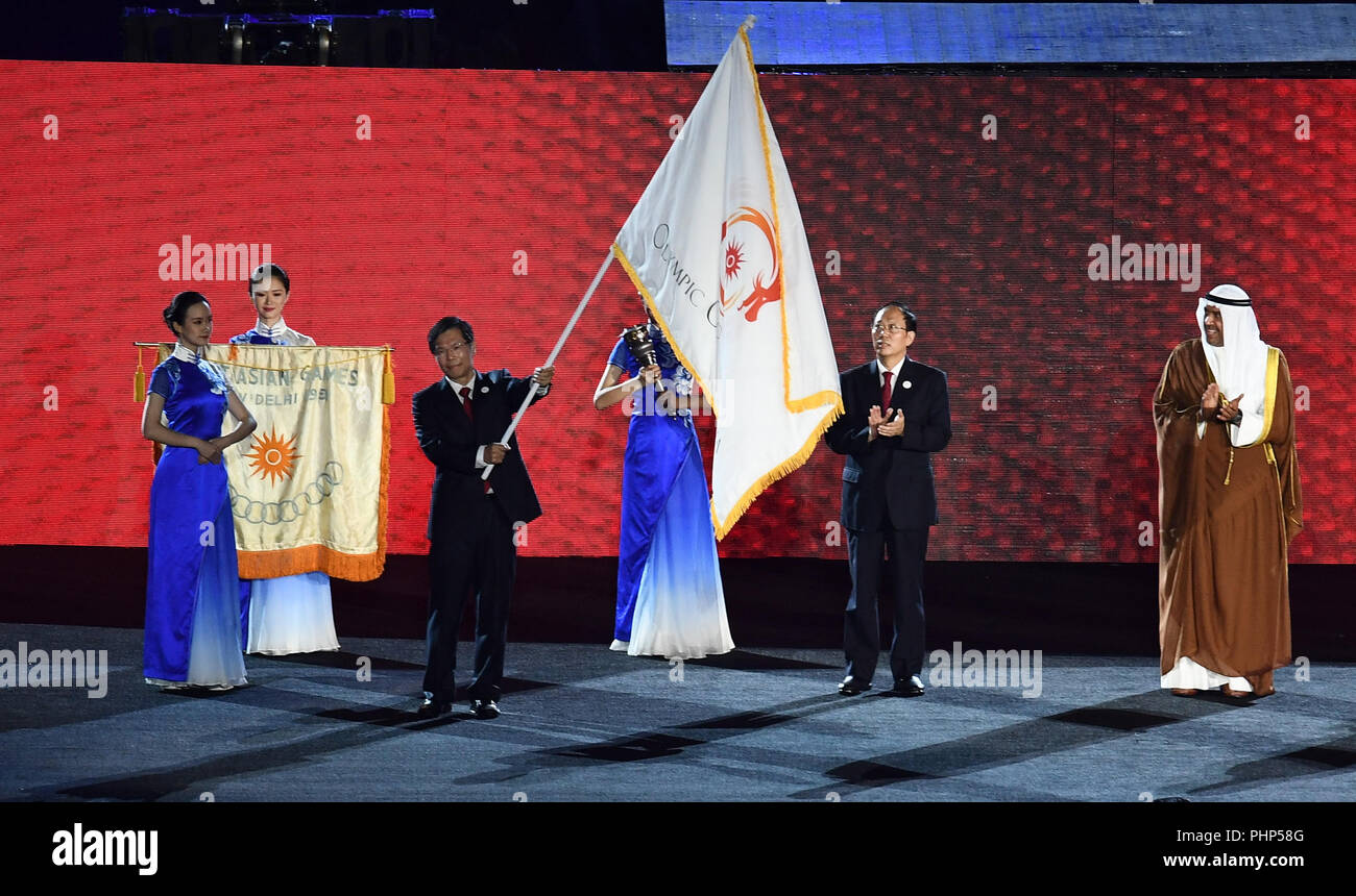 (180902) -- JAKARTA, Sept. 2, 2018 (Xinhua) -- Photo taken on Sept. 2, 2018 shows the handover ceremony of the flag of Olympic Council of Asia (OCA) during the closing ceremony of the 18th Asian Games at the Gelora Bung Karno (GBK) Main Stadium in Jakarta, Indonesia. (Xinhua/Li Xiang) Stock Photo