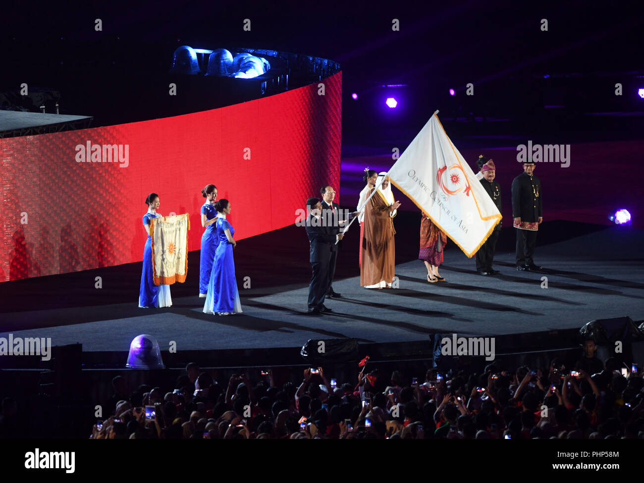 (180902) -- JAKARTA, Sept. 2, 2018 (Xinhua) -- Photo taken on Sept. 2, 2018 shows the handover ceremony of the flag of Olympic Council of Asia (OCA) during the closing ceremony of the 18th Asian Games at the Gelora Bung Karno (GBK) Main Stadium in Jakarta, Indonesia. (Xinhua/Pan Yulong) Stock Photo