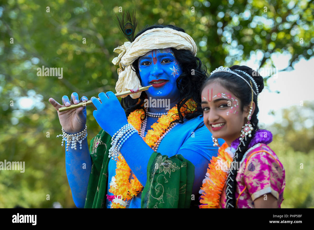 Watford, UK. 2 September 2018. (L to R) Kushal and Shivanee, students at Avanti School in Stanmore, dress as Lord Krishna and his consort Radharani, as thousands of devotees attend the biggest Janmashtami festival outside of India at the Bhaktivedanta Manor Hare Krishna Temple in Watford, Hertfordshire.  The event celebrates the birth of Lord Krishna and take place at a property donated to the Hare Krishna movement by ex Beatle George Harrison.  Credit: Stephen Chung / Alamy Live News - Stock Image