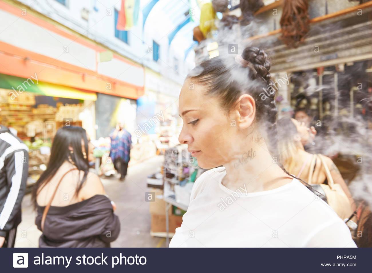 Young woman smoking - Stock Image