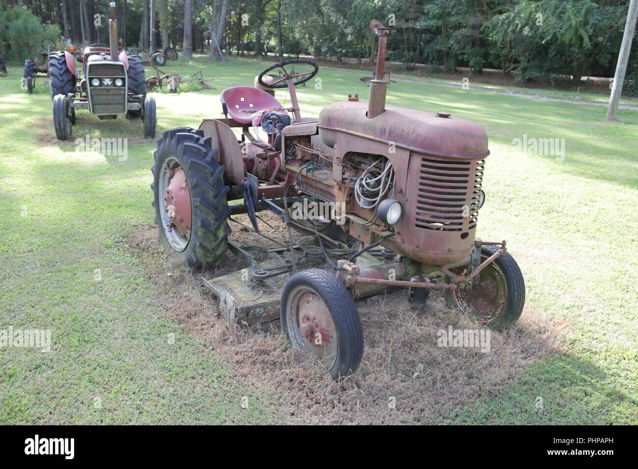 old rusty tractors in junkyard - Stock Image