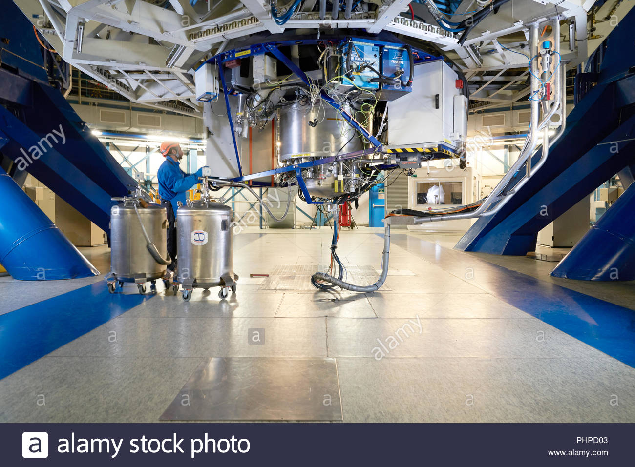 Astronomer adjusting machinery at Paranal Observatory in Chile - Stock Image