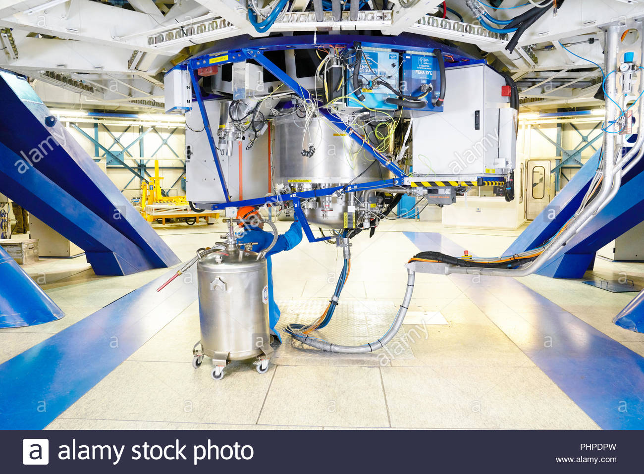 Scientist doing maintenance on telescope at Paranal Observatory - Stock Image