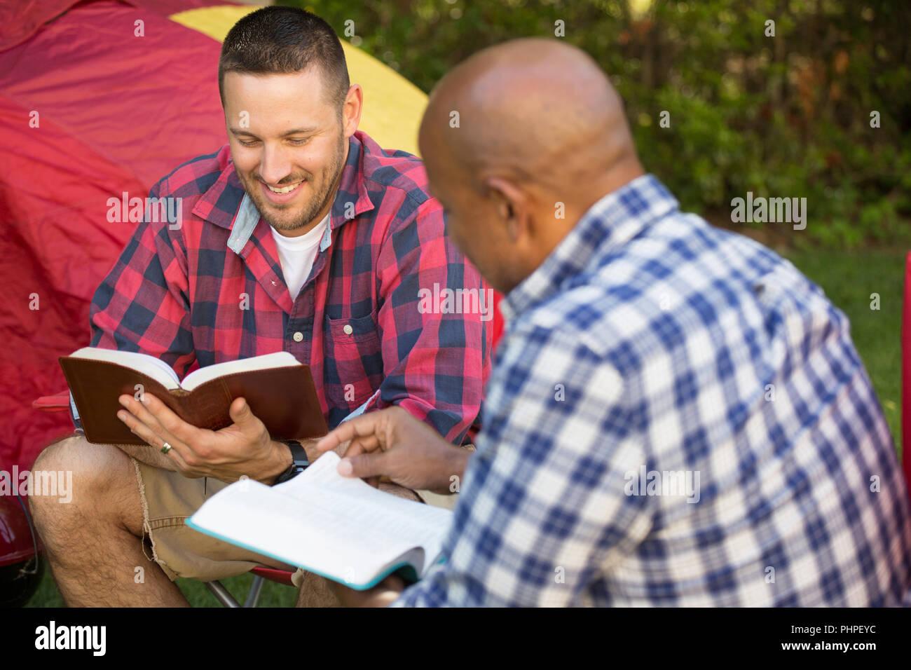 Men having a bible study. - Stock Image