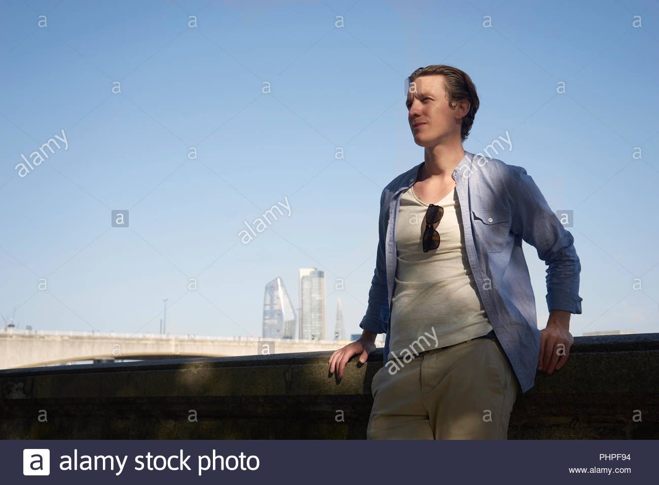 Mid adult man in shadow - Stock Image