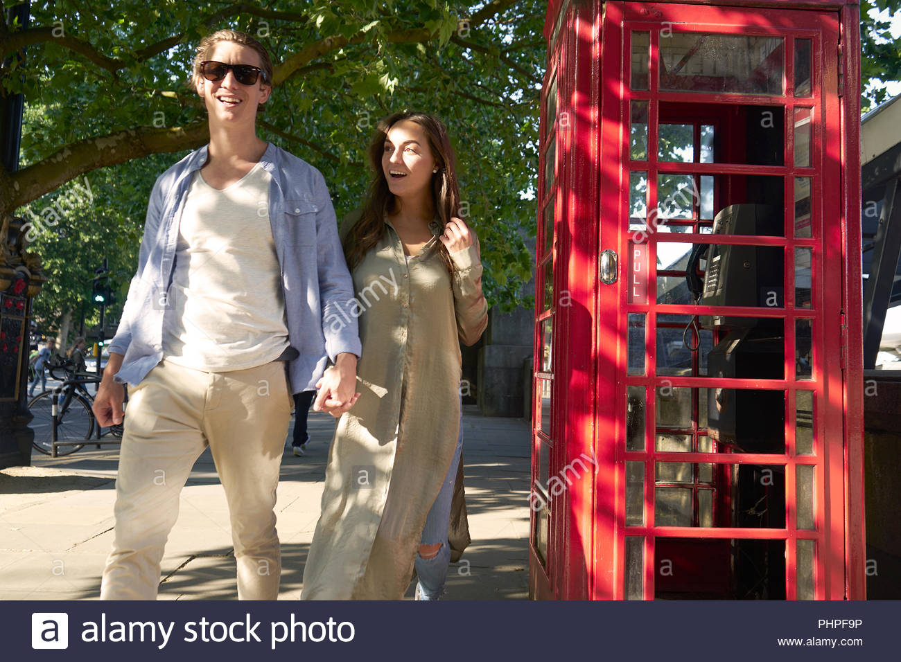 Couple by red telephone box - Stock Image