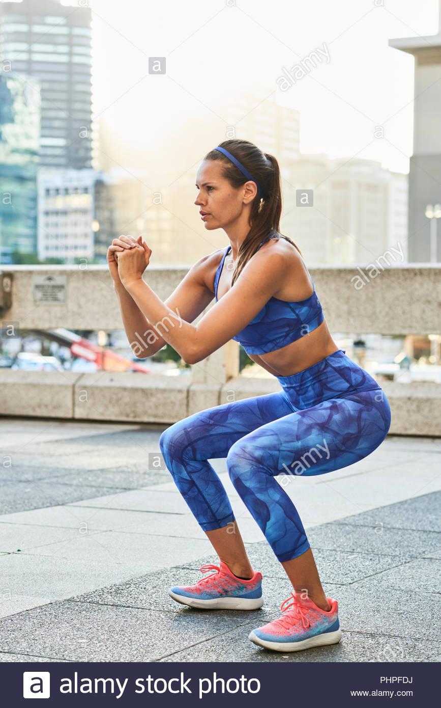 Woman squatting - Stock Image