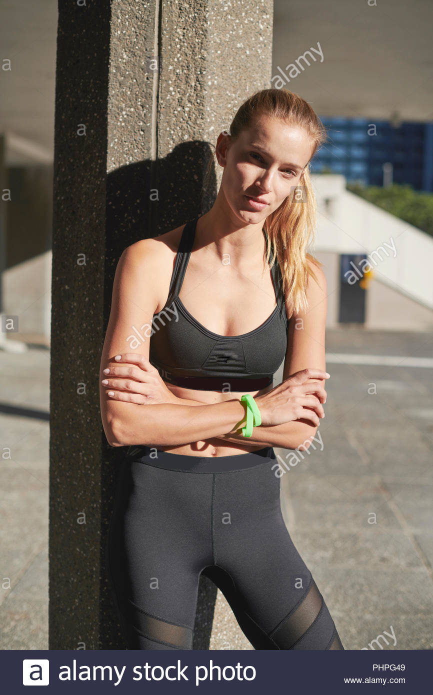 Woman wearing black sports bra - Stock Image