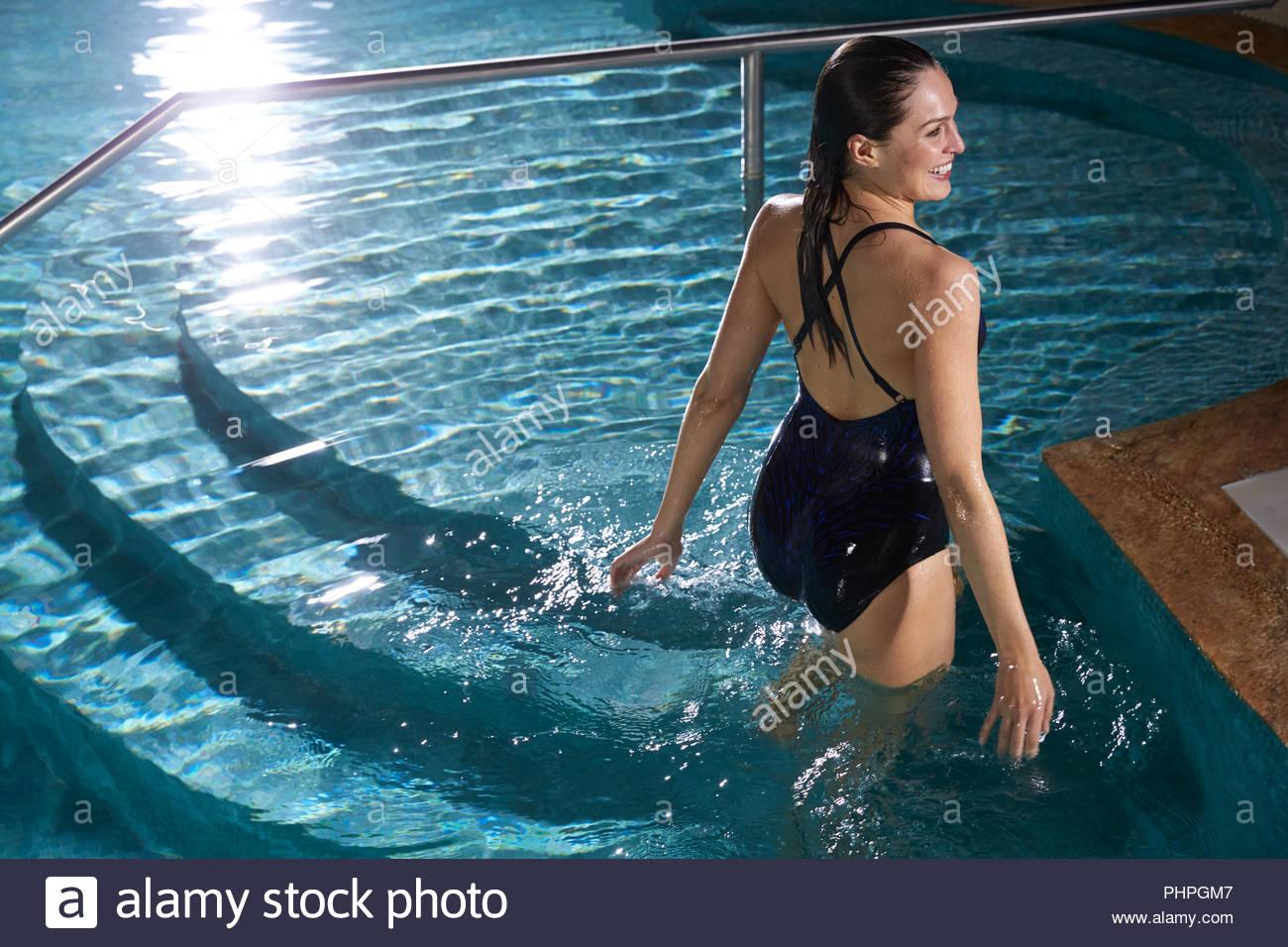 Woman wearing black swimsuit standing in swimming pool Stock ...