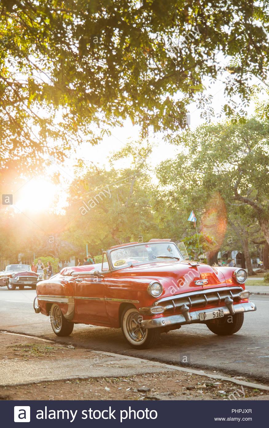 Red vintage car in Havana, Cuba - Stock Image