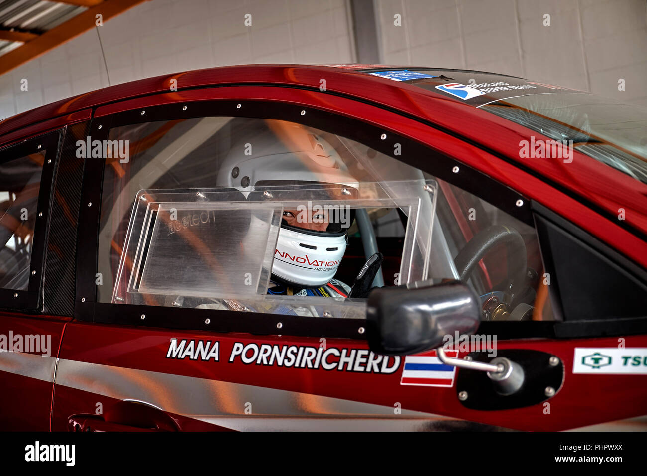 Racing driver. Through the window view of a driver behind the wheel of a racing saloon car - Stock Image