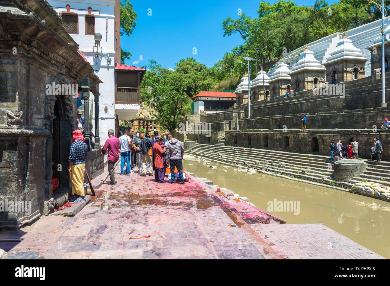 Kathmandu, Nepal – 13.04.2018: Burial ceremony on the banks of the Bagmati river in the Pashupatinath Temple 13 April 2018, Kathmandu, Nepal. - Stock Image
