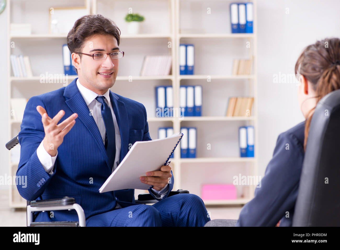 Disabled businessman having discussion with female colleague Stock Photo