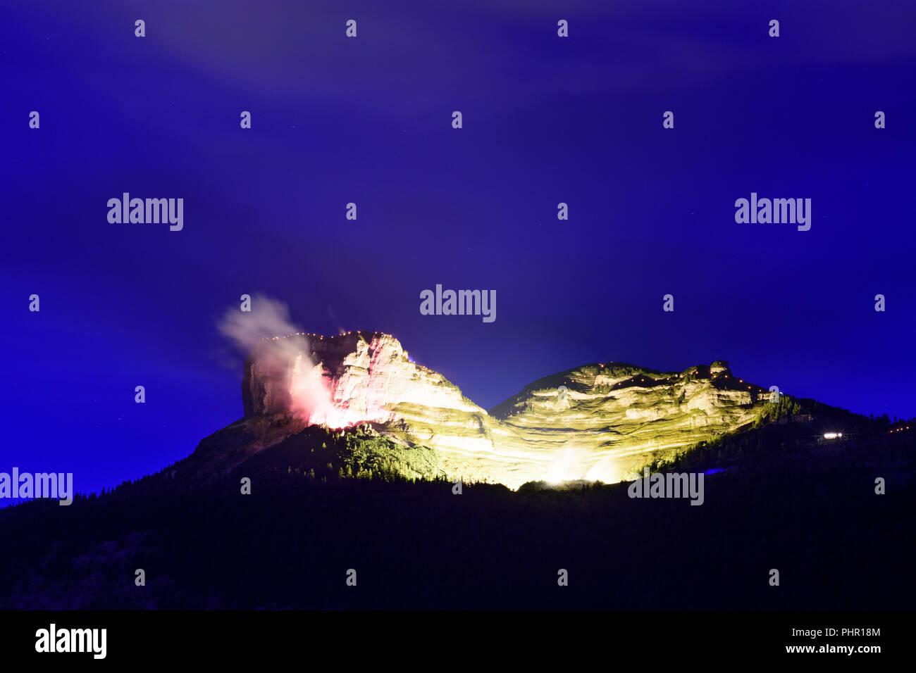 Altaussee: illuminated mountain Loser  at festival 'Berge in Flammen' (mountains in flames), Ausseerland-Salzkammergut, Steiermark, Styria, Austria - Stock Image