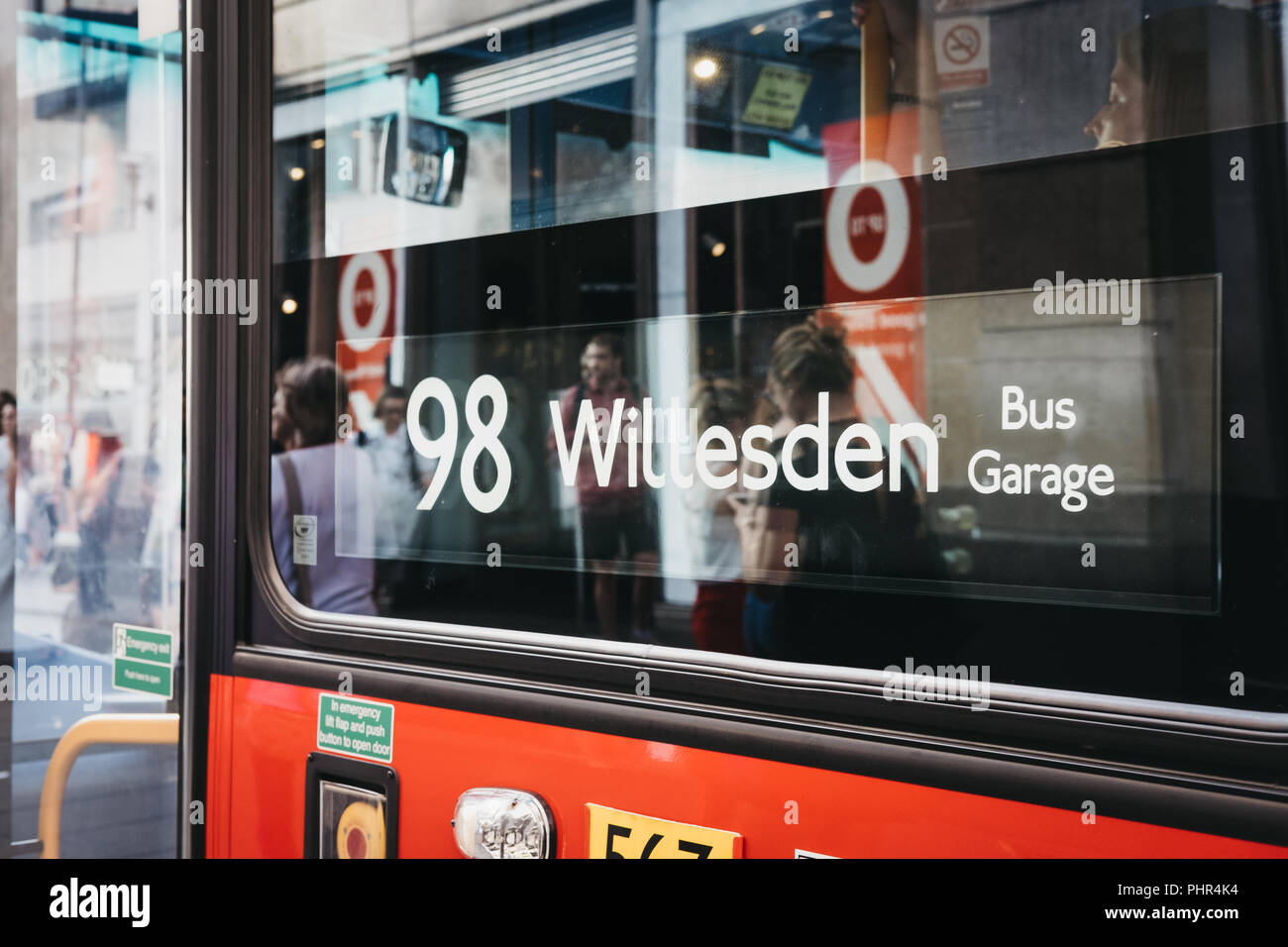 London, UK - July 24, 2018: Close up of a red double decker bus number 98 sign towards Willesden on Oxford Street, London, UK. Double decker bus is an - Stock Image