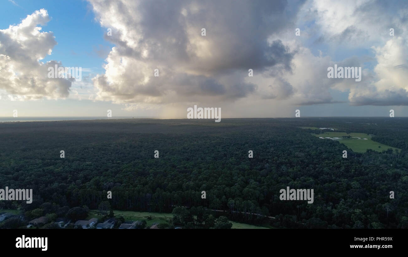 Drone Photo Captures Clouds and Distant Rain - Stock Image
