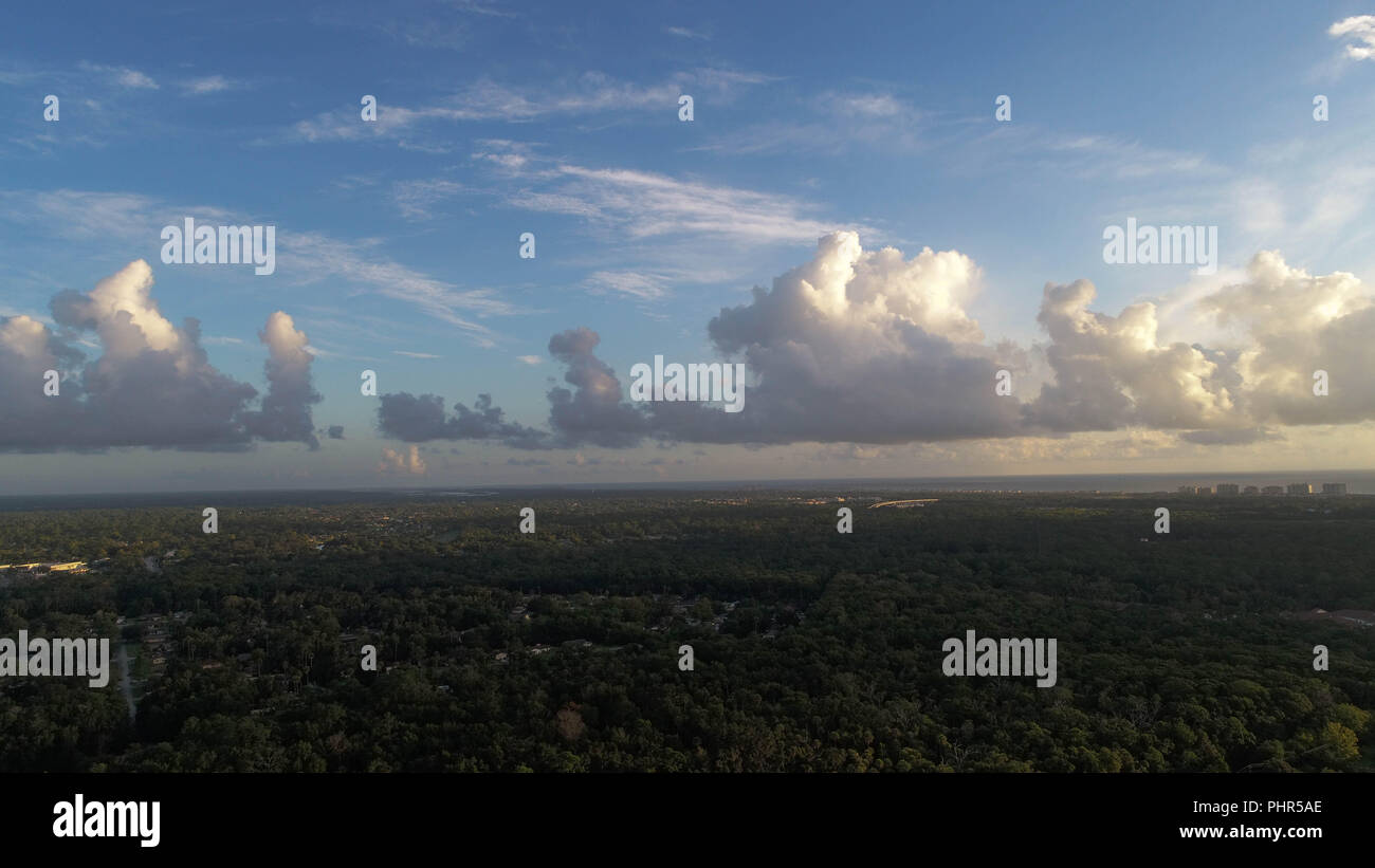 Dramatic Cloudy Sky Aerial Coastal Sunrise Image - Stock Image