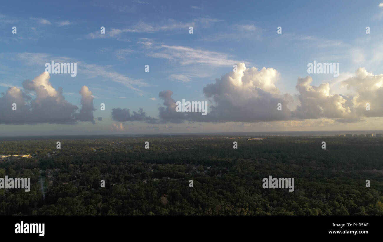 Drone Photograph Of View Of Clouds In Daytime Near Coast - Stock Image
