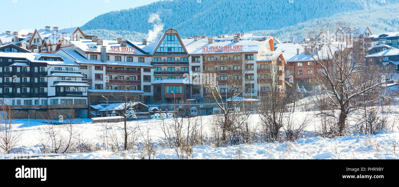 Bansko, Bulgaria - November 30, 2016: St. Ivan Rilski hotel and snow mountains panorama in bulgarian ski resort Bansko - Stock Image