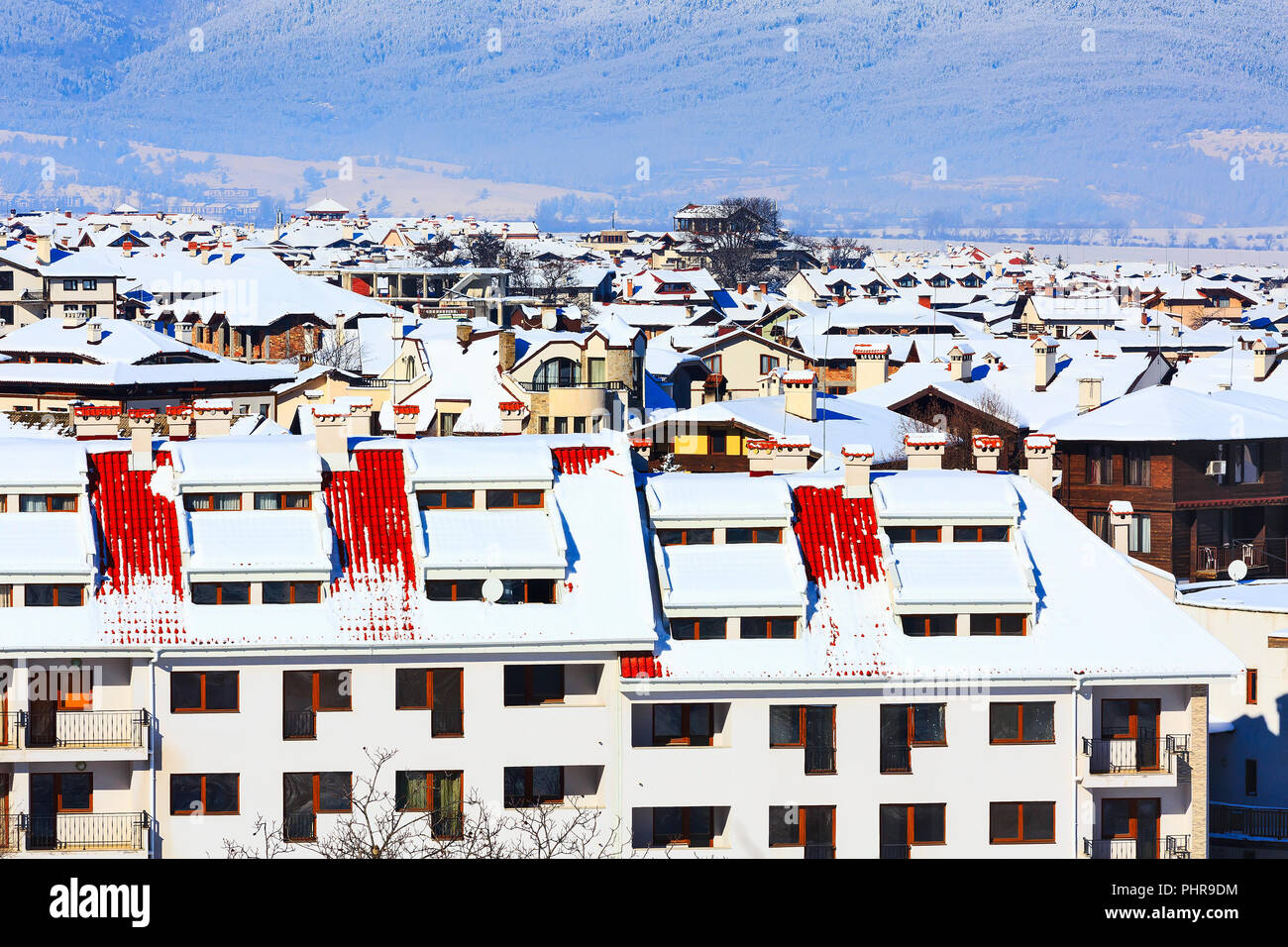 Houses with snow roofs panorama of bulgarian ski resort Bansko, Bulgaria - Stock Image