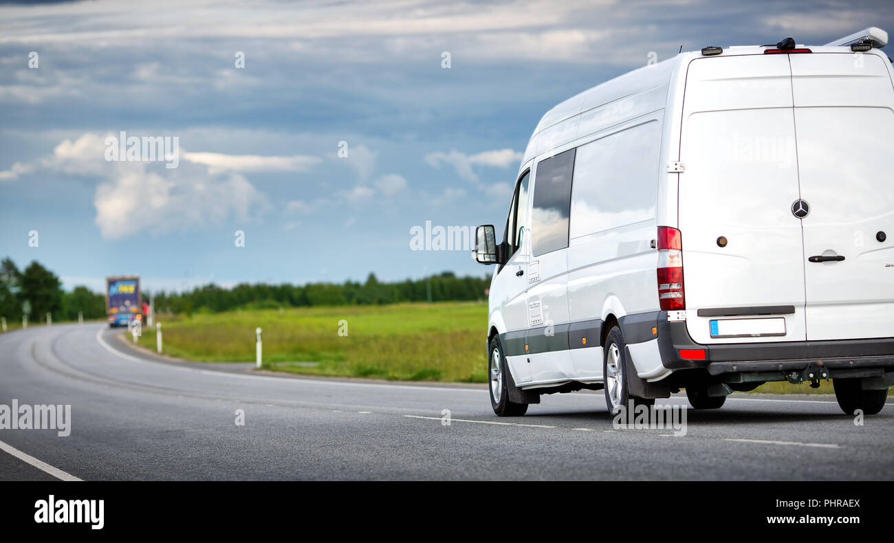 asphalt road on with a small truck Stock Photo