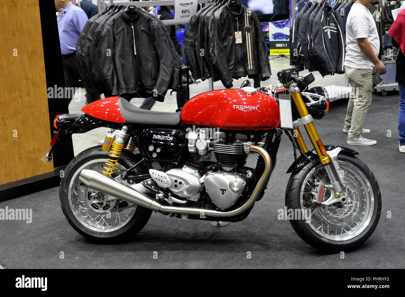 Big bike and custom motorcycle in huge showroom. Displayed to crowd for sale. - Stock Image