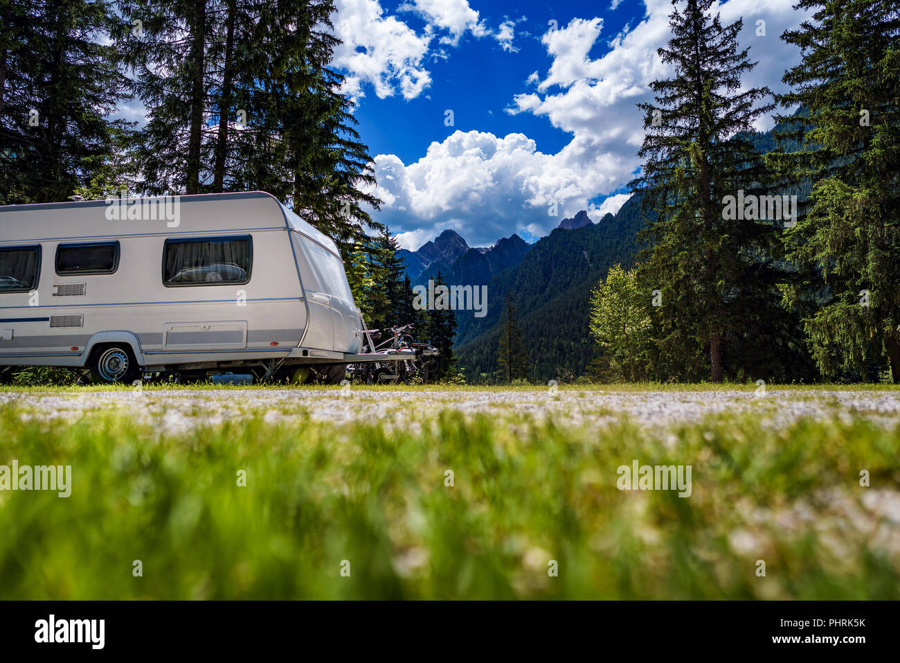 Family vacation travel, holiday trip in motorhome RV, Caravan car Vacation. Beautiful Nature Italy natural landscape Alps. - Stock Image