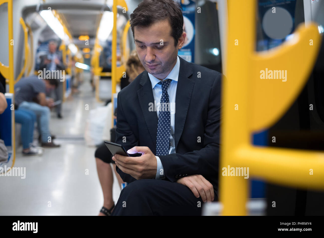Commuter on underground is going to work - Stock Image