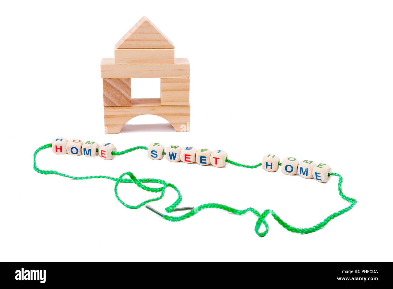 Wooden house and home sweet home text. - Stock Image