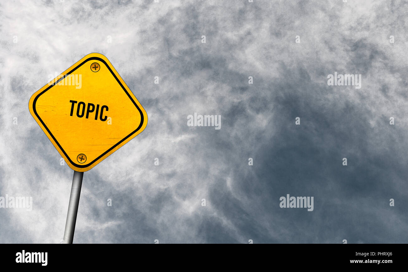 topic - yellow sign with cloudy sky - Stock Image