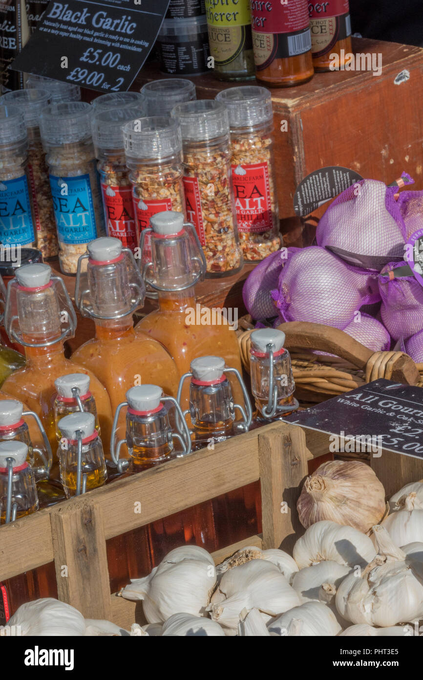 a selection of garlic flavoured products including pickles and mayonnaise on sale at a shop at the garlic farm on the isle of wight. - Stock Image